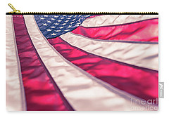 Carry-all Pouch featuring the photograph American Flag In Red White Stripe,stars And Blue Symbolic Of Pat by Jingjits Photography