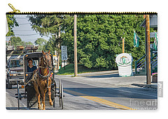 Carry-all Pouch featuring the photograph Amish Girl On The Road by Patricia Hofmeester