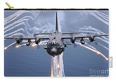 Carry-all Pouch featuring the photograph An Ac-130h Gunship Aircraft Jettisons by Stocktrek Images