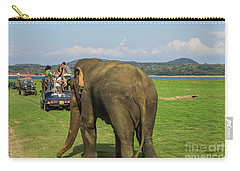 Carry-all Pouch featuring the photograph Angry Male Elephant Near Safari Jeeps by Patricia Hofmeester