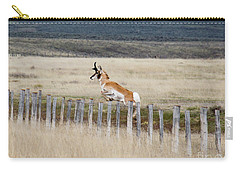 Carry-all Pouch featuring the photograph Antelope Jumping Fence 1 by Rebecca Margraf