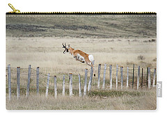 Carry-all Pouch featuring the photograph Antelope Jumping Fence 2 by Rebecca Margraf