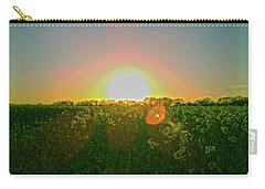 Carry-all Pouch featuring the photograph April Sunrise by Anne Kotan