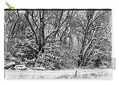 Carry-all Pouch featuring the photograph Three Tires And A Snowstorm by Bill Kesler