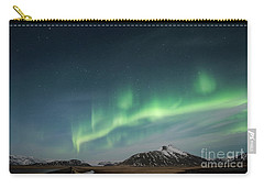 Carry-all Pouch featuring the photograph Aurora Borealis Over Iceland by Sandra Bronstein