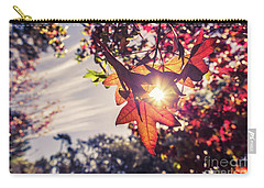 Carry-all Pouch featuring the photograph Autumn Sky And Colorful Leaves In Fall Season With Sun Shine On  by Jingjits Photography