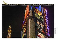 Carry-all Pouch featuring the photograph Ballys Sign In Front Of The Eiffel Tower At Night by Aloha Art