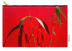 Bamboo Against Red Wall Carry-all Pouch