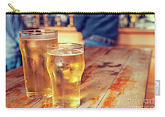 Carry-all Pouch featuring the photograph Beers In A Pub by Patricia Hofmeester