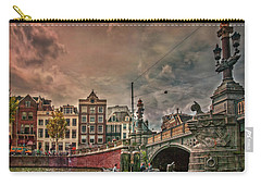 Carry-all Pouch featuring the photograph Blauwbrug -blue Bridge- by Hanny Heim