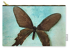 Brown Butterfly Over Blue Textured Background Carry-all Pouch