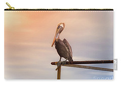 Brown Pelican Sunset Carry-all Pouch by Robert Frederick