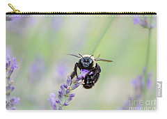 Carry-all Pouch featuring the photograph Bumblebee On The Lavender Field by Andrea Anderegg