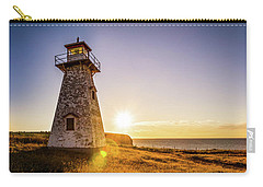 Carry-all Pouch featuring the photograph Cape Tryon Light Sunset by Chris Bordeleau