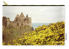 Carry-all Pouch featuring the photograph Castle Ruins And Yellow Wildflowers Along The Irish Coast by Juli Scalzi