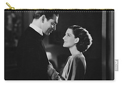 Carry-all Pouch featuring the photograph Clark Gable Staring In A Free Soul by R Muirhead Art
