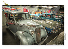 Carry-all Pouch featuring the photograph Classic Car Memorabilia by Adrian Evans