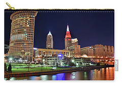 Carry-all Pouch featuring the photograph Cle Over The Cuyahoga by Frozen in Time Fine Art Photography