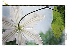 Carry-all Pouch featuring the photograph Clematis Vine And Leaves by Michelle Calkins