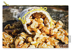 Closeup Of Walnuts Spilling From Small Bag Carry-all Pouch