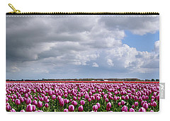 Clouds Over Purple Tulips Carry-all Pouch by Mihaela Pater