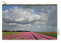 Clouds Over The Purple Tulip Field Carry-all Pouch by Mihaela Pater