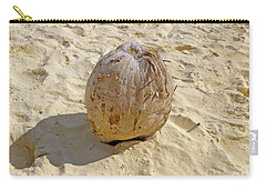 Carry-all Pouch featuring the photograph Coconut In The Sand by Francesca Mackenney