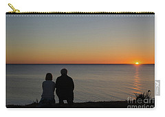 Carry-all Pouch featuring the photograph Couple Silhouettes By Sunset by Kennerth and Birgitta Kullman