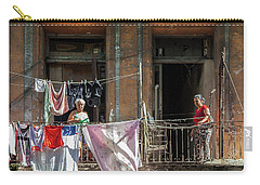 Carry-all Pouch featuring the photograph Cuban Women Hanging Laundry In Havana Cuba by Charles Harden