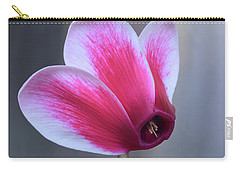 Carry-all Pouch featuring the photograph Cyclamen Portrait. by Terence Davis