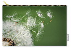 Carry-all Pouch featuring the photograph Dandelion Blowing by Bess Hamiti