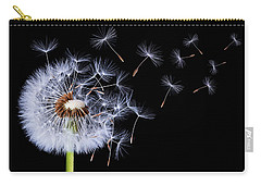 Dandelion Blowing On Black Background Carry-all Pouch by Bess Hamiti