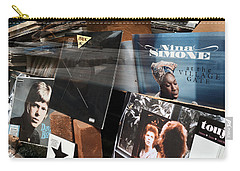 Carry-all Pouch featuring the photograph David Bowie And Nina Simone - Greenwich Village Record Store by Madeline Ellis