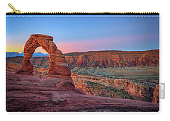 Carry-all Pouch featuring the photograph Dawn At Delicate Arch by Rick Berk