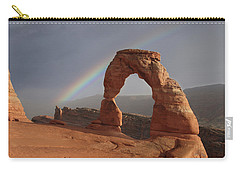 Carry-all Pouch featuring the photograph Delicate Arch And Rainbow by Marie Leslie