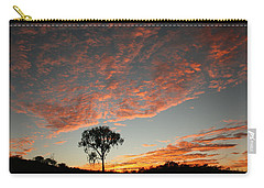 Carry-all Pouch featuring the photograph Desert Oak Tree Silhouetted At Sunrise by Keiran Lusk