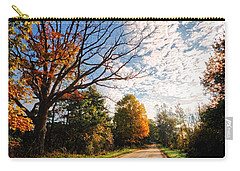 Carry-all Pouch featuring the photograph Dirt Road And Sky In Fall by Lars Lentz