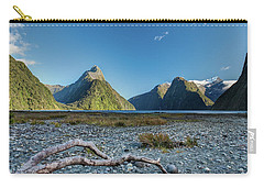 Carry-all Pouch featuring the photograph Driftwood In Milford Sound by Gary Eason
