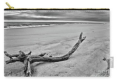 Driftwood On The Beach In Black And White Carry-all Pouch by Paul Ward