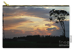 Carry-all Pouch featuring the photograph Electrified Sunset by Arik Baltinester