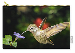 Carry-all Pouch featuring the photograph Female Hummingbird And A Small Blue Flower Left Angled View by William Lee
