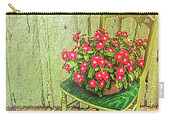 Flowers On Green Chair Carry-all Pouch by Lewis Mann