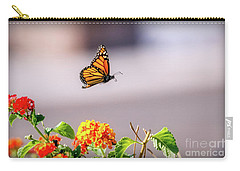 Carry-all Pouch featuring the photograph Flying Monarch Butterfly by Robert Bales