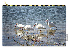 Four Ibises Walking In Water Carry-all Pouch by Carol Groenen