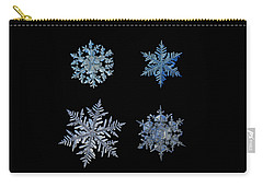 Four Snowflakes On Black Background Carry-all Pouch