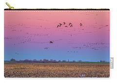 Geese Flying At Sunset Carry-all Pouch by Marc Crumpler