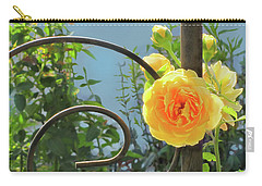 Carry-all Pouch featuring the photograph Golden Ruffled Rose On Iron Trellis by Nancy Lee Moran