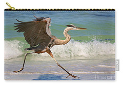 Great Blue Heron Running In The Surf Carry-all Pouch by Myrna Bradshaw