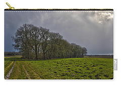 Carry-all Pouch featuring the photograph Group Of Trees Against A Dark Sky by Frans Blok