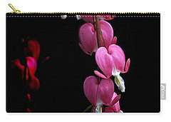 Carry-all Pouch featuring the photograph Hearts In The Dark by Susan Capuano
